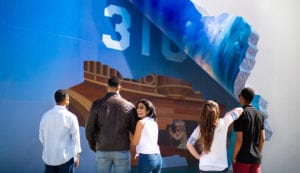 Group of friends looking at Boatmen Mural in Lompoc
