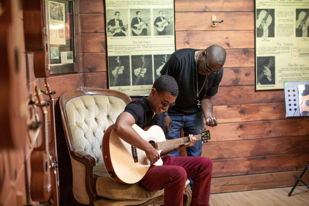 Father son playing guitar